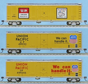 Union Pacific Railroad 50-ft boxcar models with yellow and silver scheme equipped cushion underframe, manufactured by MDC-Roundhouse
